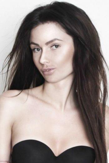 Ukrainian girl Vitalina,26 years old with grey eyes and dark brown hair.