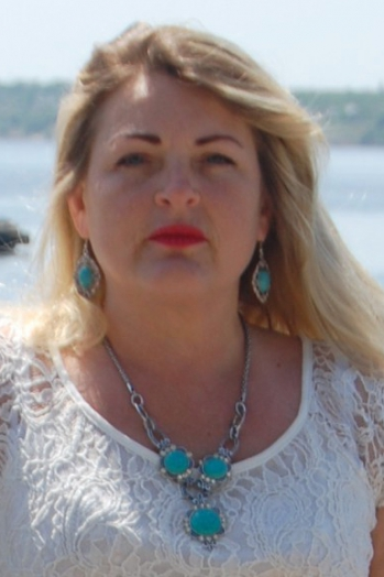 Ukrainian girl Ludmila,45 years old with grey eyes and blonde hair.