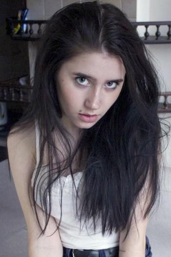 girl Oksana , years old with  eyes and  hair.