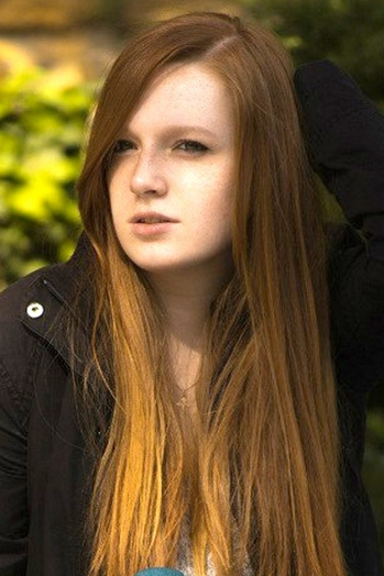 Ukrainian girl Alena,20 years old with green eyes and red hair.