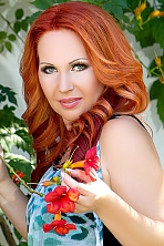 Ukrainian girl Olga,34 years old with grey eyes and auburn hair.
