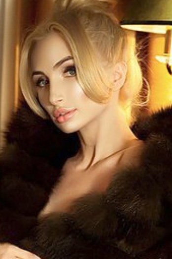 Ukrainian girl Daria,21 years old with blue eyes and blonde hair.