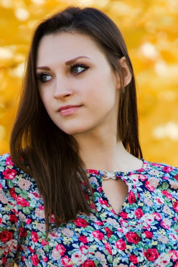 Ukrainian girl Anna,25 years old with green eyes and dark brown hair.