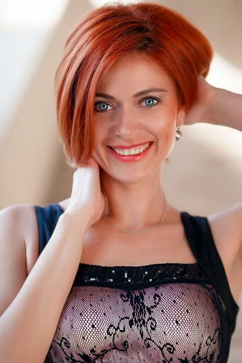 Ukrainian girl Alena,38 years old with blue eyes and red hair.