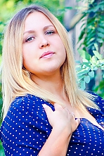 Ukrainian girl Mariya,20 years old with grey eyes and light brown hair.