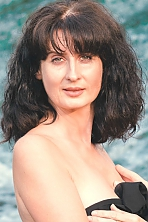 Ukrainian girl Nataliya,43 years old with green eyes and dark brown hair.