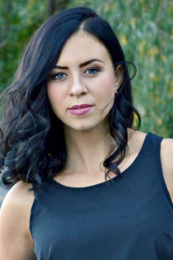Ukrainian girl Anastasiya,24 years old with green eyes and black hair.