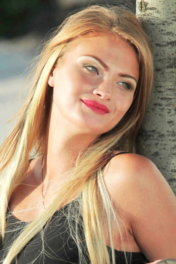Ukrainian girl Julia,20 years old with green eyes and blonde hair.