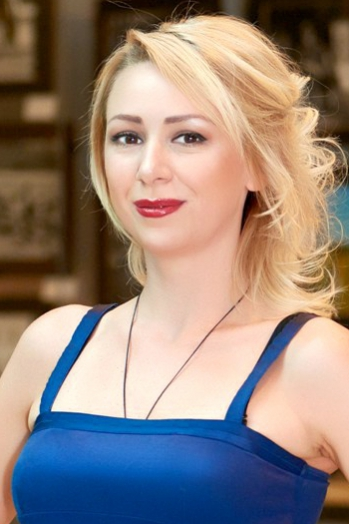 Ukrainian girl Irina,33 years old with brown eyes and blonde hair.