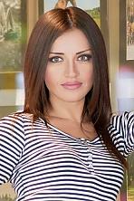 Ukrainian girl Ekaterina,36 years old with green eyes and dark brown hair.