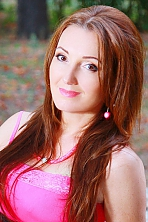 Ukrainian girl Tatiana,44 years old with brown eyes and dark brown hair.