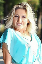 Ukrainian girl Nataliya,45 years old with brown eyes and blonde hair.