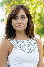 Ukrainian girl Daria,28 years old with brown eyes and dark brown hair.