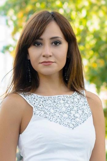 Ukrainian girl Daria,28 years old with brown eyes and dark brown hair.