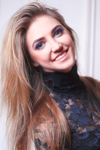 Ukrainian girl Maria,25 years old with green eyes and light brown hair.