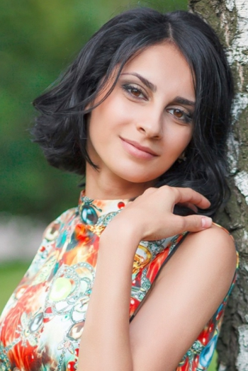 Ukrainian girl Karina,26 years old with brown eyes and black hair.