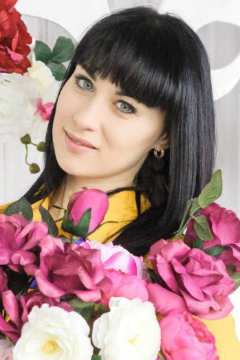 Ukrainian girl Anastasiia,22 years old with blue eyes and black hair.