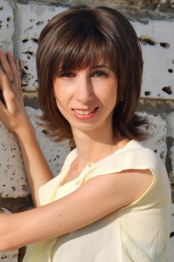 Ukrainian girl Juliya,34 years old with green eyes and dark brown hair.