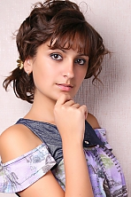 Ukrainian girl Nataly,25 years old with hazel eyes and dark brown hair.