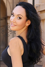 Ukrainian girl Elena,37 years old with brown eyes and black hair.