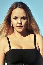 Ukrainian girl Irina,30 years old with hazel eyes and blonde hair.