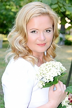 Ukrainian girl Natalia,38 years old with green eyes and blonde hair.