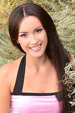 Ukrainian girl Yulia,34 years old with brown eyes and dark brown hair.