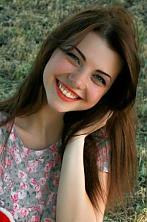 Ukrainian girl Elena,21 years old with green eyes and dark brown hair.