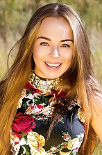 girl Natalia, years old with  eyes and  hair.