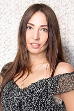 Ukrainian girl Eugenia,38 years old with hazel eyes and dark brown hair.