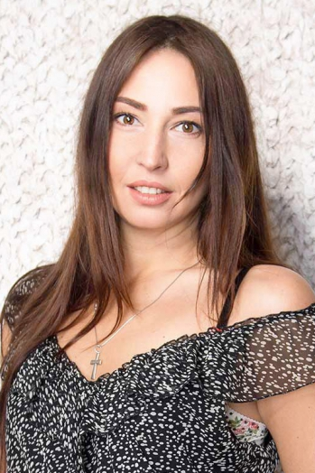 Ukrainian girl Eugenia,38 years old with hazel eyes and dark brown hair.