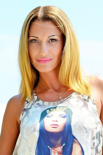 Ukrainian girl Diana,42 years old with brown eyes and blonde hair.