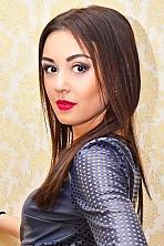 Ukrainian girl Juliya,20 years old with brown eyes and black hair.