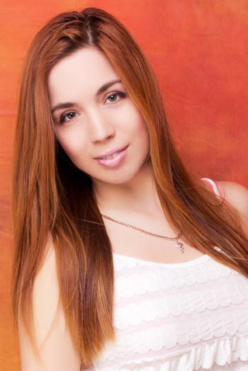 Ukrainian girl Nataliya,27 years old with hazel eyes and red hair.