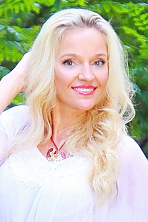 Ukrainian girl Larisa,45 years old with grey eyes and blonde hair.