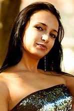 Ukrainian girl Olga,29 years old with brown eyes and dark brown hair.