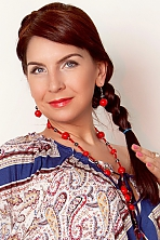 Ukrainian girl Olga,36 years old with grey eyes and red hair.