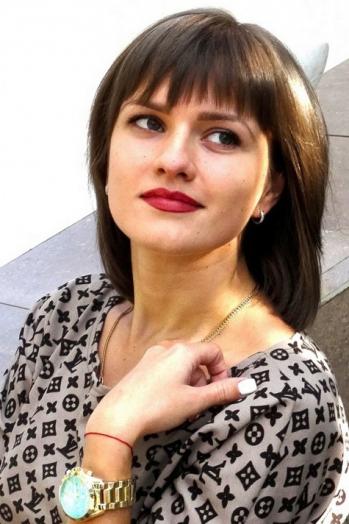 Ukrainian girl Svetlana,25 years old with green eyes and dark brown hair.