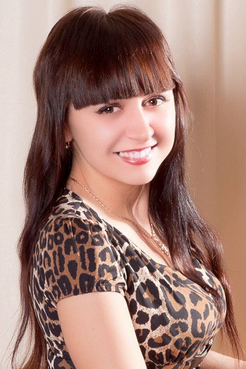 girl Oksana, years old with  eyes and  hair.
