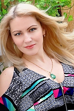 Ukrainian girl Oksana,35 years old with grey eyes and blonde hair.