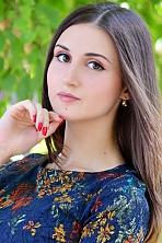 Ukrainian girl Dariya,19 years old with brown eyes and dark brown hair.