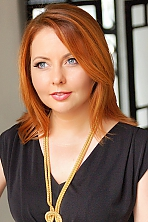 Ukrainian girl Inessa,38 years old with grey eyes and red hair.