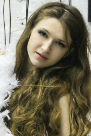 Ukrainian girl Yevgeniya,22 years old with blue eyes and light brown hair.