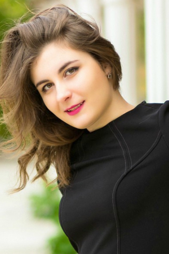 Ukrainian girl Marina,27 years old with green eyes and dark brown hair.