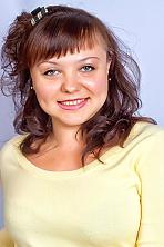 Ukrainian girl Irina,38 years old with green eyes and dark brown hair.