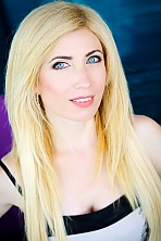 Ukrainian girl Alexandra,45 years old with blue eyes and blonde hair.