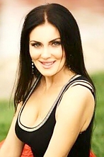 Ukrainian girl Anna,40 years old with blue eyes and light brown hair.