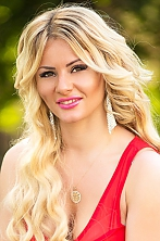 Ukrainian girl Anna,29 years old with brown eyes and blonde hair.