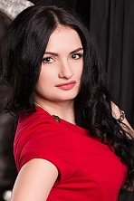 Ukrainian girl Elena,31 years old with blue eyes and dark brown hair.