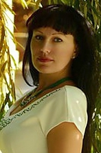 Ukrainian girl Alla,37 years old with blue eyes and dark brown hair.